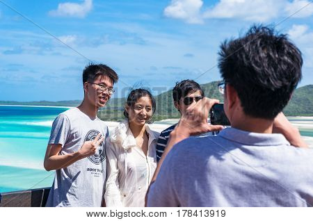 Whitsunday Australia - February 5 2017: People taking photos shots on the background of lagoon.