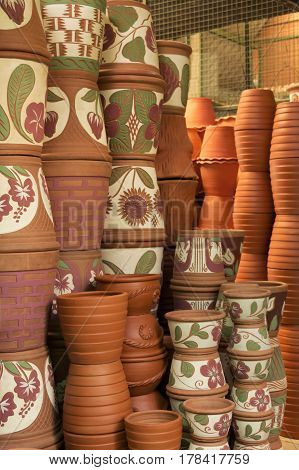 Stack towers of Clay flower pots in store