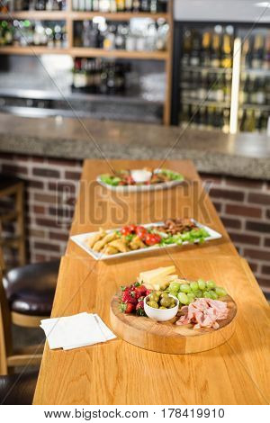 Food laid out on table in bar
