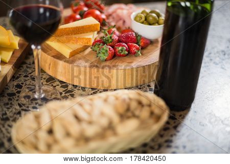 Wine bottle with a glass and a buch of food in a bar