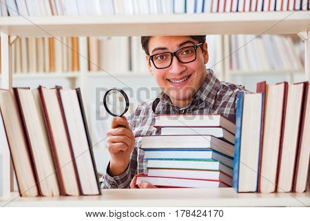 Young student looking for books in college library