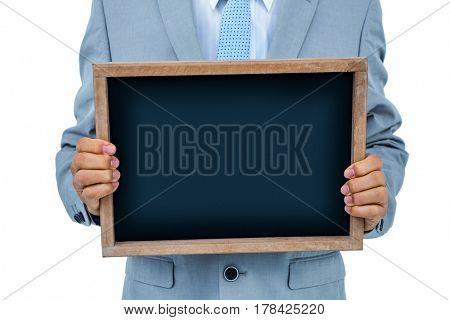 Businessman showing black board on white background