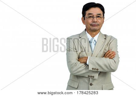 Serious businessman smiling to the camera