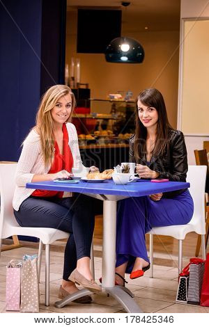 Women having coffee and snacks at a coffee shop in shopping mall