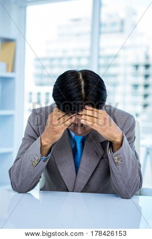 Worried businessman at his desk in office