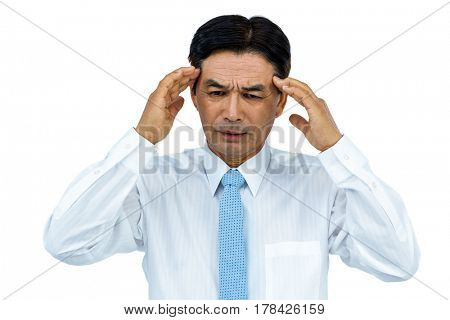 Businessman with severe headache on white background