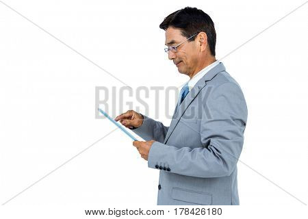 Businessman using his tablet on white background