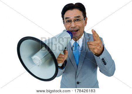 Asian businessman talking through megaphone on withe background