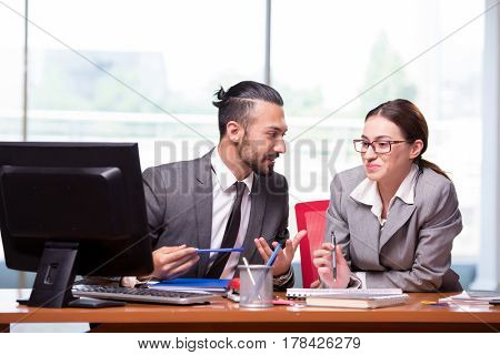 Woman and man in the business concept