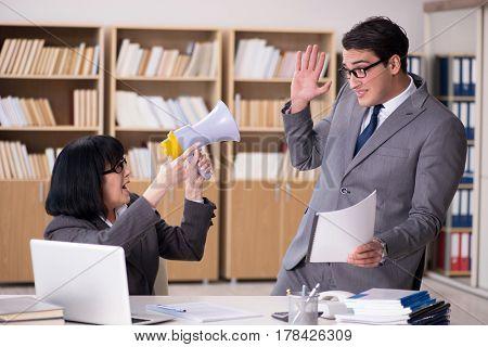 Angry boss reprimanding subordinate employee