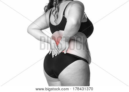 Back pain fat woman with backache overweight female body isolated on white background black and white photo with red spots