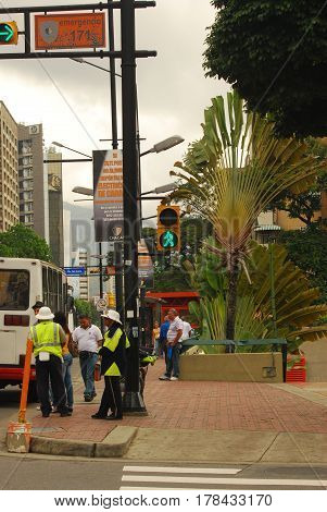 Caracas,Venezuela-January 14,2011: Traffic Policemen stand at a busy intersection in the Chacao district
