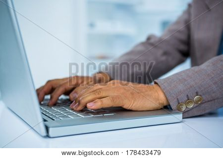 Businessman working on his laptop in office