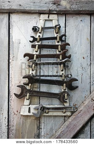 Old German and Soviet wrenches on a wooden wall