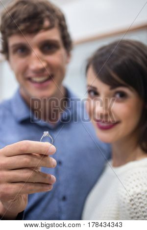 Couple with a diamond ring in jewelry shop