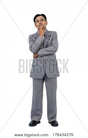 Businessman with hand on chin on white background