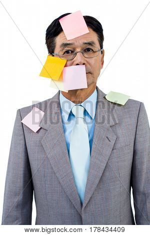 Businessman with blank note over his face on white background