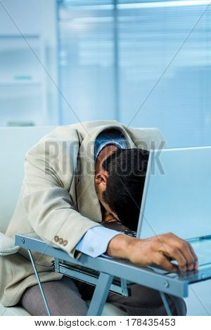 Tired asian businessman sleeping in office