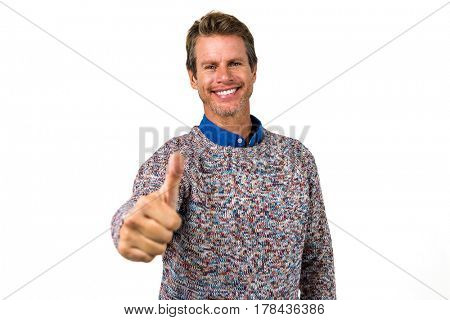 Close-up portrait of happy man showing thumps sign against white background