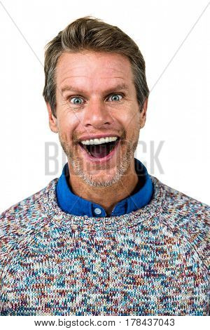 Close-up portrait of shocked man against white background