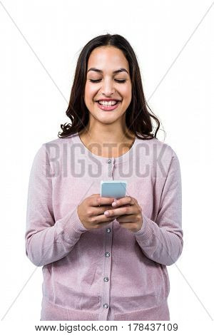 Smiling happy woman using mobile phone against white background
