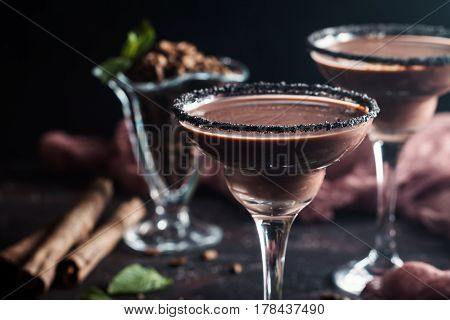 glasses of cream coffee cocktail or chocolate martini on black background
