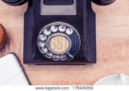 Close-up of old land line on table