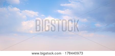 Sky background on sunset. Nature composition. Panoramic sunset sky background. Sunrise sky with lighted clouds. Beauty evening sunrise.