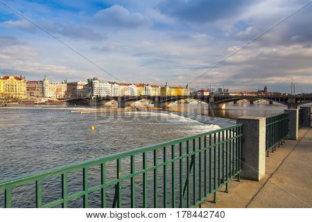 Prague Czech Republic - March 20 2017: View on the Prague panorama with Jirasek bridge at sunset.The Prague bridges arching over the Vltava River are not only vital connecting links but also valuable works of architecture .