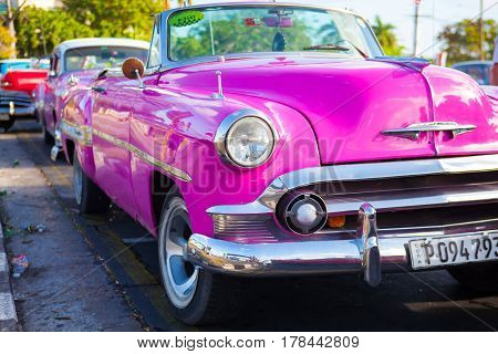 Havana Cuba - January 22 2017: Old american car on the road Old Havana Cuba.Thousands of these cars are still in use in Cuba and they have become an iconic view and a worldwide known attraction