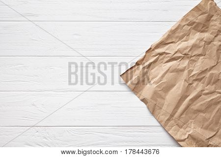 White wooden table background board texture with aged decorative parchment paper backdrop frame