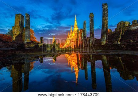 Asian religious architecture. Reflection ancient pagoda at Wat Phra Sri Sanphet temple under twilight sky after the rain. Ayutthaya Province Thailand