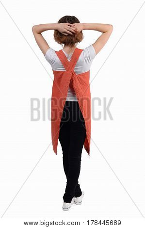 Young redhaired woman chef, waiter or bartender posing, wearing apron and t-shirt isolated on white background. Bartender's clothes.