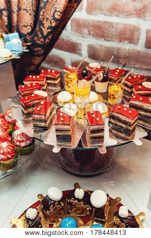 different pastries on the wedding candybar. Table served for wedding party
