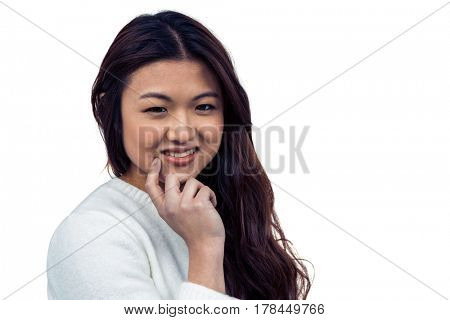 Smiling Asian woman with hand on chin looking at the camera on white screen