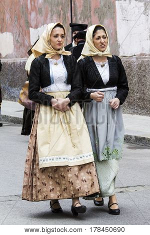 CAGLIARI, ITALY - May 1, 2016: 360 Feast of Saint Efisio portrait of beautiful women parading in traditional Sardinian costume - Sardinia