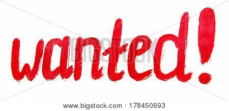 Conceptual hand drawn inscription: wanted. Red painting stroke sketch.Paper texture background.