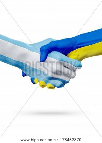 Flags Argentina Ukraine countries handshake cooperation partnership friendship or national sports team competition concept isolated on white