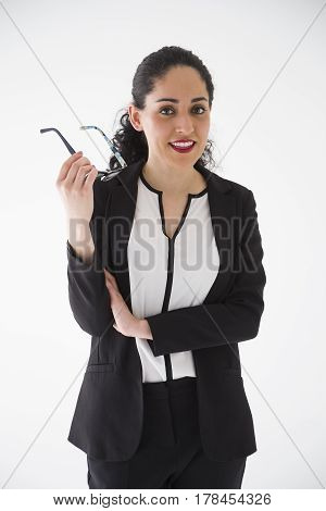 Portrait of businesswoman with glasses on white background
