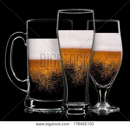 Silhouette of beer glasses with bubbles on a black background