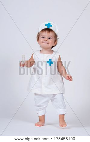 child playing as a doctor with syringe.