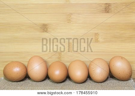 Egg on wooden table with bamboo plank background