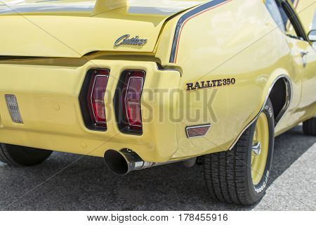 Rear view of yellow Oldsmobile Cutlass Rallye350 at a classic car show in Prattville Alabama on May 30 2015.