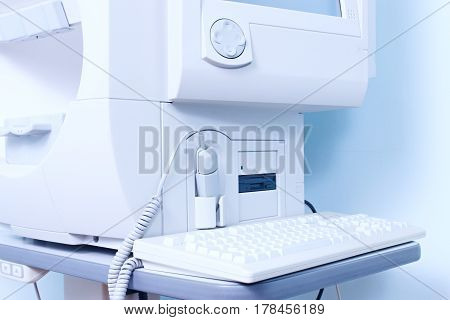 Equipment for ophthalmology. Computer and optical equipment for testing eyesight in the clinic.