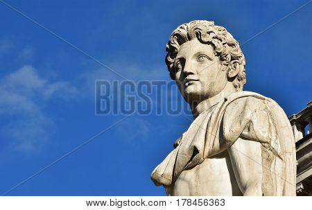 Detail of Dioskouri ancient roman marble statue from the Capitol Hill Square balustrade with blue sky