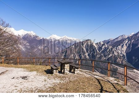 Wooden table and bench on Monte San Simeone with beautiful view to Monte Chiampon