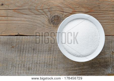 White sugar on wooden table top view