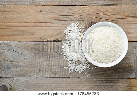 White rice in bowl on table top view