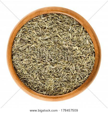 Dried thyme in wooden bowl. Minced stems. Herb with culinary and medicinal uses. Thymus vulgaris is a relative of oregano. Isolated macro food photo close up from above on white background.