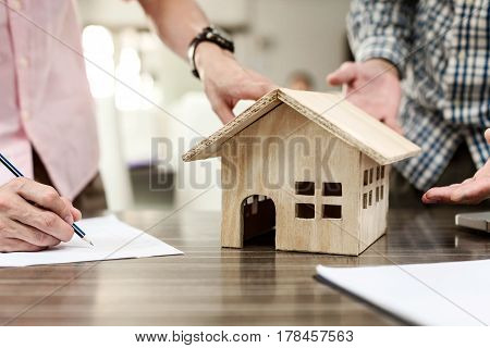 Real-estate Agent Sign For Home Contract Property For Sale In The Office With Buyer.
